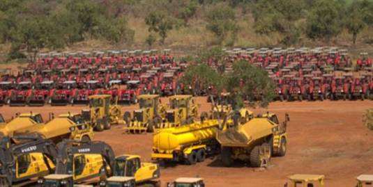 Saudi Star caterpillars, tractors, bulldozers, trucks and other heavy equipment parked near a 10,000 hectare plot of Indigenous land.
